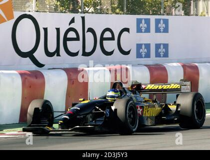 Brazilian driver Cristiano da Matta drives during the first qualifying session for the Molson Indy in Montreal, Quebec, August 23, 2002. Da Matta took the provisional pole position with a time of one minute 19.465 seconds. It is the first time the CART series has come to Montreal with the race being run on August 25. REUTERS/Christinne Muschi  JY Stock Photo