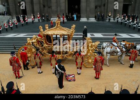 Britain's Queen Elizabeth II (in blue) stands at the entrance of St. Paul's Cathedral after arriving by the Coronation Carriage for the Golden Jubilee Service of Thanksgiving in London June 4, 2002. Thousands of people gathered in central London for the festivities on the final day of the celebratory weekend marking the Queen's 50th year on the throne. The golden coach was first seen in public in 1762, when King George III travelled to the state opening of parliament. It cost a hefty 7,562 pounds to make, the equivalent of over $1 million today. It was last used at the Queen's Silver Jubilee i