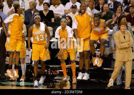 University of Tennessee bench celebrates as head coach Pat Summitt (R) remains calm in the final seconds of their win over Duke University of the NCAA Women's semi-final game at the Georgia Dome, April 6, 2003. Tennessee defeated Duke 66-56. REUTERS/Alan Mothner  TLC - Stock Photo