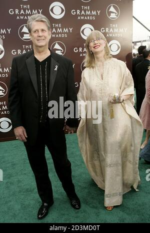 Former Beach Boy Brian Wilson and his wife Melinda arrive at the 47th annual Grammy Awards at the Staples Center in Los Angeles February 13, 2005. Wilson won for Best Rock Instrumental Performance for 'Mrs. O'Leary's Cow.' REUTERS/Robert Galbraith  FG