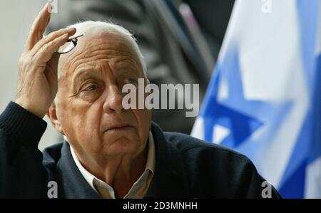 ISRAELI PRIME MINISTER ARIEL SHARON ATTENDS A CABINET MEETING NEAR THE ISRAELI CHECKPOINT AT THE ENTRANCE TO THE PALESTINIAN CITY OF JENIN. - Stock Photo