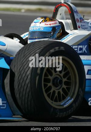Canadian CART driver Alex Tagliani drives through the hairpin during the morning practice for the Molson Indy in Montreal, August 23, 2002. It is the first time the CART series has come to Montreal with the race being run on August 25. REUTERS/Christinne Muschi  JY Stock Photo