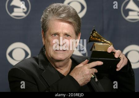 Former Beach Boy Brian Wilson holds his award backstage at the 47th annual Grammy Awards at the Staples Center in Los Angeles February 13, 2005. Wilson won for Best Rock Instrumental Performance for 'Mrs. O'Leary's Cow.' REUTERS/Robert Galbraith  FG