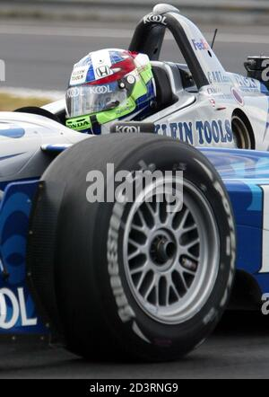 Scottish CART driver Dario Franchitti races through the hairpin on his way to winning the Molson Indy in Montreal, August 25, 2002. Franchitti finished first, followed by Brazilians Cristiano da Matta in second, and Tony Kanaan in third. REUTERS/Christinne Muschi  JY/jp Stock Photo