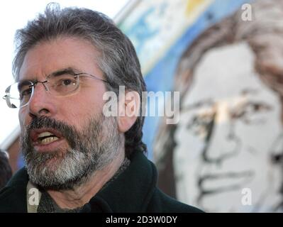 Sinn Fein's president Gerry Adams MP speaks during an outdoor news conference at the Sinn Fein's headquarters on the Falls Road, west Belfast, December 2, 2004. The Sinn Fein leader stated that they have made their final representation to both the British and Irish governments on their proposals and it is now time for a decision. REUTERS/Paul McErlane  PM/JV