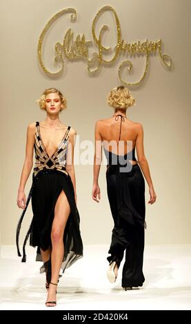Model present creations by Australian designer Collette Dinnigan at her Spring-Summer ready-to-wear women's fashion collection for 2004 in Paris, October 12, 2003. - Stock Photo