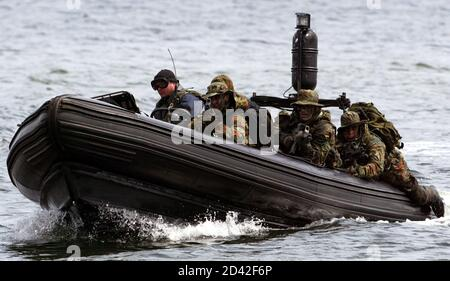 Members of German Navy Special Operations Forces use a speedboat during an exercise in the Baltic Sea near the northern German town of Eckernfoerde, July 1, 2004. [The German Navy Special Operations Forces of the German Armed Forces Bundeswehr whose membership of which is kept secret, are chiefly involved in military operations.]