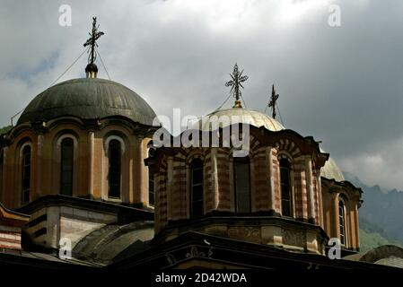 A view of the dome of main church at the Rila Monastery, some 125 km south-west from Sofia on June 18, 2003. Rila Monastery, the biggest Bulgarian monastery was founded in the l0th century by the Bulgarian monk St. John of Rila and was rebuilt in the l3th - l4th century. In the l5th century, when Bulgaria fell to the Ottoman Turks, the monastery was abandoned for a short time but in the second half of the same century it was restored to a new life. Later it was plundered and ravaged several times. A thorough renovation of the monastery began in the early l9th century. REUTERS/Oleg Popov  OP/AS - Stock Photo
