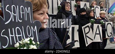Belgrade women, members of a pacifist non-government organization 'Women in black', hold anti-war posters during a protest in the centre of Belgrade February 15, 2003. The women joined other demonstrators protesting against a possible U.S.-led war on Iraq.  REUTERS/Ivan Milutinovic Stock Photo