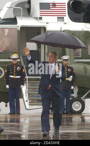 U.S. President George W. Bush gestures before departing from Waco, Texas January 2, 2005 in Waco. Bush, who has been working on his inaugural and State of the Union addresses while spending the holidays at his Crawford ranch, is returning to Washington. REUTERS/Mike Theiler  MT