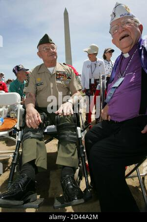 Retired U.S. Marine Corps Master Sgt. John Kenes (L) talks with retired U.S. Air Force Chaplain, Lt. Col. Rev. Francis Jeffery before the dedication ceremony for the National WW II Memorial in Washington May 29, 2004. The memorial honors the 16 million people who served in the U.S. armed forces during WW II, the more then 400,000 who died and the millions who supported the war effort at home. REUTERS/Win McNamee  GMH/SV
