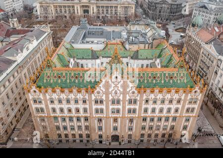 Budapest, Hungary - Feb 10, 2020: Aerial drone shot of Hungarian State Treasury Postal Bank in Budapest before sunrise
