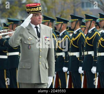 French Army Chief of Staff General Thorette salutes during welcoming ceremony at Japan Defense Agency in Tokyo.  French Army Chief of Staff General Bernard Thorette salutes as he reviews a guard of honour at the Japanese Defense Agency in Tokyo January 27, 2005. Thorette flew in to Tokyo on Wednesday for a six-day visit to promote friendship, understanding and trust between the French Army and the Japan Ground Self-Defense Force (JSDF), the JSDF said. REUTERS/Toru Hanai Stock Photo
