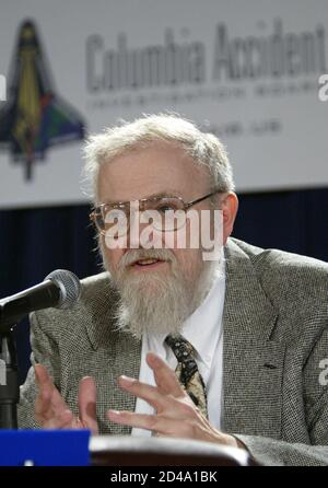 Dr. James Hallock, a member of the Columbia Accident Investigation Board, gestures during a press conference on the Space Shuttle Columbia disaster in Washington, D.C., July 11, 2003. The board won't issue a final report on the Columbia accident until the end of August, a month later then expected. REUTERS/Evan Vucci  EJV/GAC