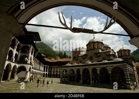 A general view of the main church at the Rila Monastery, some 125 km south-west from Sofia on June 18, 2003. Rila Monastery, the biggest Bulgarian monastery was founded in the l0th century by the Bulgarian monk St. John of Rila and was rebuilt in the l3th - l4th century. In the l5th century, when Bulgaria fell to the Ottoman Turks, the monastery was abandoned for a short time but in the second half of the same century it was restored to a new life. Later it was several times plundered and ravaged. Its thorough renovation began in the early l9th century. REUTERS/Oleg Popov  OP/AS - Stock Photo
