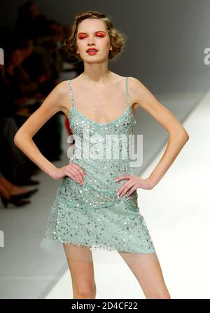 A model presents this creation by Australian designer Collette Dinnigan at her Spring-Summer ready-to-wear women's fashion collection for 2004 in Paris, October 12, 2003. - Stock Photo