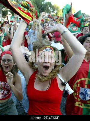 Portugal team fans celebrate in the fan park in Lisbon after Portugal's Cristiano Ronaldo scores the opening goal against the Netherlands in the semi final of the Euro 2004 soccer championships on June 30, 2004. REUTERS/Oleg Popov  OP/THI