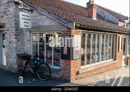 An English traditional sweet shop in a small market town of Helmsley is the only market town set on the edge of the North York Moors National Park in - Stock Photo