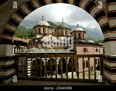A general view of the main church at the Rila Monastery, some 125 km south-west from Sofia on June 18, 2003. Rila Monastery, the biggest Bulgarian monastery was founded in the l0th century by the Bulgarian monk St. John of Rila and was rebuilt in the l3th - l4th century. In the l5th century, when Bulgaria fell to the Ottoman Turks, the monastery was abandoned for a short time but in the second half of the same century it was restored to a new life. Later it was plundered and ravaged several times. A thorough renovation of the monastery began in the early l9th century. RIGHTS FREE REUTERS/Oleg  - Stock Photo
