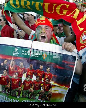 Portugal team fans celebrate in the fan park in Lisbon after Portugal's Cristiano Ronaldo scores the opening goal against the Netherlands in the semi-final of the Euro 2004 soccer championships on June 30, 2004. REUTERS/Oleg Popov  OP/THI