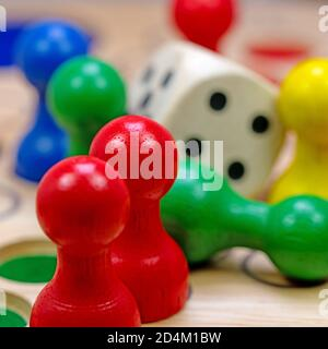 Dice and colorful game figures for board games