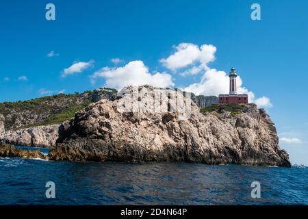 Faro Punta Carena Lighthouse in Anacapri, Capri, Italy seen from the Sea, a Beacon on a Cliff