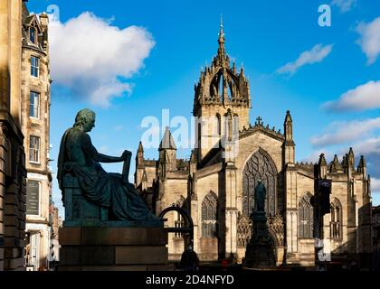 Statue of David Hume and to rear St Giles Cathedral at Lawnmarket on Royal Mile, Edinburgh, Scotland - Stock Photo