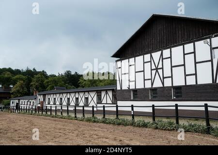Walbrzych, Poland - 15 July 2020: Dworzysko Complex. Restored 19th-century farm in a rustic style located at the foot of Chelmiec Mountain - Stock Photo
