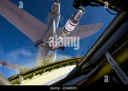 A U.S. Air Force 96th Bomb Squadron pilot positions a U.S. Air Force 2nd Bomb Wing B-52H Stratofortress behind a U.S. Air Force 60th Air Mobility Wing KC-10 Extender over Saudi Arabia in support of Bomber Task Force Europe 20-1, Nov. 1, 2019. The Stratofortress conducted a sortie to the U.S. Central Command area of operations in order to conduct interoperability training with Saudi partners in support of shared regional security interests. (U.S. Air Force photo by Tech. Sgt. Christopher Ruano)