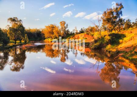Macquarie river in Dubbo city of Australia NSW western plains at sunset in warm sun light.