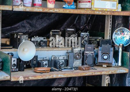 Vintage old photo cameras displayed nicely in a market stall in a garage sale in cuba