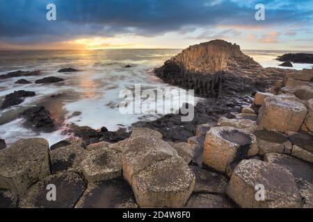 Giant Causeway rocks at sunset in Northern Ireland