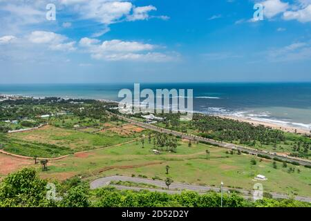 top view of sea beach road looking awesome from top of a mountain with blue sky & beautiful sea view.
