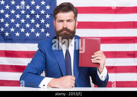Handsome lawyer man promoting american constitutional liberties, legal advice concept.