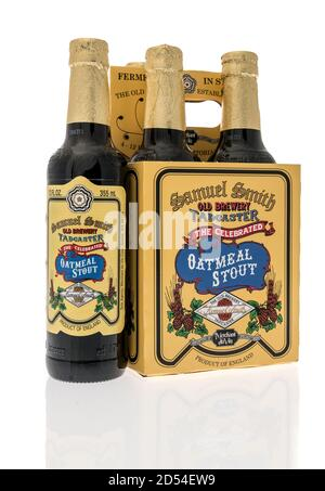 Winneconne, WI - 6 October 2020:  A four pack of Samuel Smith tadcaster oatmeal stout beer on an isolated background. - Stock Photo