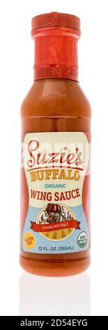 Winneconne, WI - 6 October 2020:  A bottle of Suzies buffalo wing sauce on an isolated background. - Stock Photo