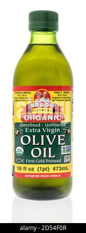 Winneconne, WI - 6 October 2020:  A bottle of Bragg olive oil on an isolated background. - Stock Photo