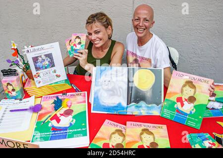 Florida Miami Dade College Wolfson Campus, International Book Fair vendor stall seller books, woman women friends author authors children's books,