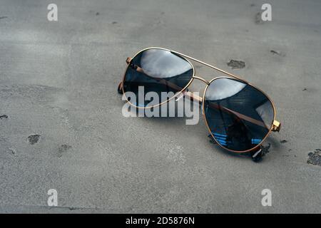 New dark aviator glasses on grey concrete background - Stock Photo