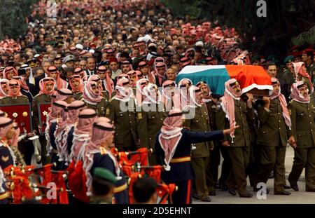 Thousands of mourners follow pall bearers carrying the coffin of King Hussein as the funeral procession stops at the Royal Guards Mosque for prayers February 8. King Hussein, who played a major role in Middle East politics during his reign, was buried on Monday after 47-years on the Hashemite throne. **DIGITAL IMAGE**