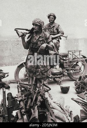 The German paratrooper with an automatic rifle FG-42. Italy. 1943 In the foreground is a weapon seized from Italian soldiers. The picture was taken af