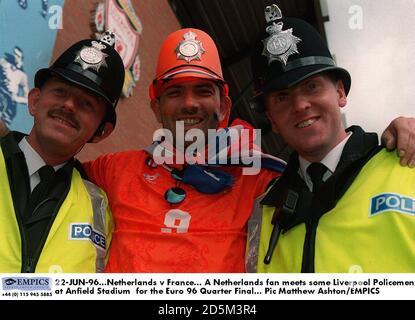 22-JUN-96. Netherlands v France.  A Netherlands fan meets some Liverpool Policemen at Anfield Stadium  for the Euro 96 Quarter Final