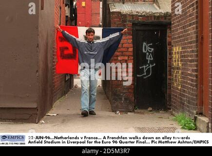 22-JUN-96. Netherlands v France.  A Frenchfan walks down an alley towards Anfield Stadium in Liverpool for the Euro 96 Quarter Final