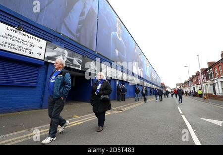 Everton fans arriving at Goodison Park ahead of the match  - Stock Photo