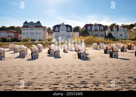 Germany, Usedom, Bansin, hooded beach chairs on the beach - Stock Photo