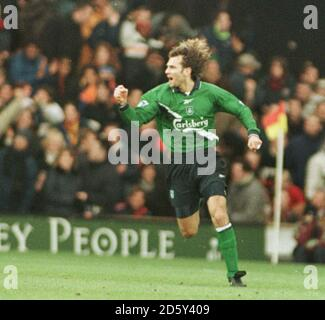 Liverpool's Patrik Berger celebrates scoring the opening goal