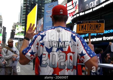 New York, United States. 13th Oct, 2020. Trump supporters march on Fifth Avenue to Times Square as contentious political and judicial topics are being debated in Washington DC. Issues concerning the health of the President and optimism of his re-election resounded among the rally participants. Credit: SOPA Images Limited/Alamy Live News - Stock Photo