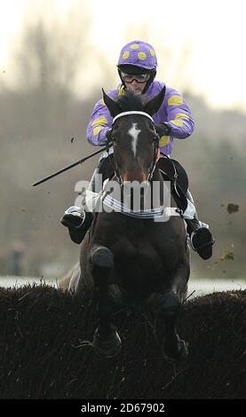 Orana Conti ridden by Jockey Thomas Phelan jumps the last fence to win the Leicester Annual Members Novices' Handicap Steeple Chase at Leicester Racecourse