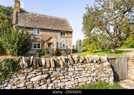 Evening light on a traditional stone cottage in the Cotswold village of Cutsdean, Gloucestershire UK