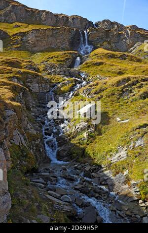 A small stream flows down the mountainside. selective focus